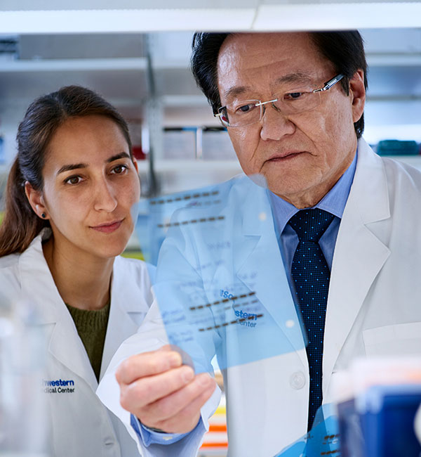 Image of Dr. Takahashi and a member of his lab